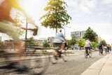 Fototapeta Miasto - A group of moving cyclists in the city