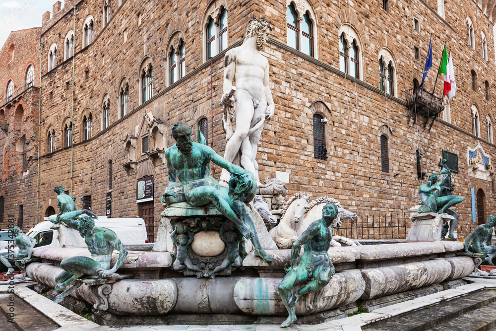 FLORENCE, ITALY - NOVEMBER 4, 2016: Fountain of Neptune near Palazzo Vecchio on Piazza della Signoria in Florence in morning. Fointain was built in1565 by sculptor Bartolomeo Ammannati