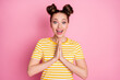 canvas print picture - Photo of attractive pretty funky lady two funny buns cheerful mood hold arms together pleading buy dress wear casual white yellow striped shirt isolated pink color background