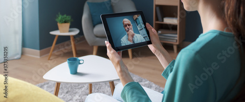 Woman having a video call with her doctor