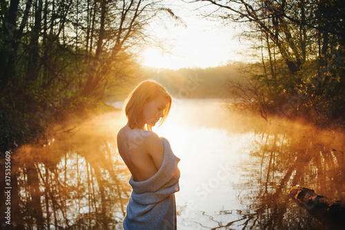 an attractive woman in nature enjoys the sunrise Canvas