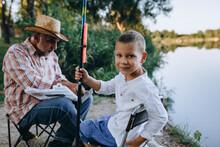 Grandfather And Grandson Fishi...