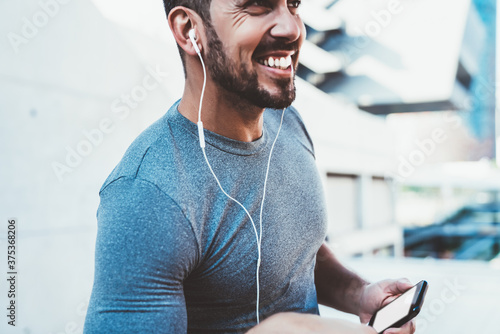 Cropped image of caucasian male athlete satisfied with keeping healthy lifestyle Slika na platnu
