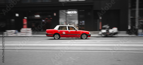 cars on the road red taxi hongkong in a rush speed movement moving forward empty Canvas Print