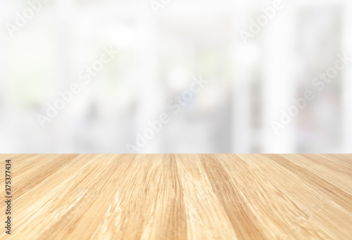 Obraz beautiful empty wood table with blur modern white kitchen and coffee cafe with window background, interior clean tone . Ready for product display  montage. - fototapety do salonu