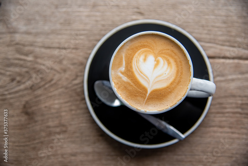 Fotografie, Obraz cup of hot latte on wooden table