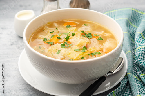 Homemade cabbage soup in bowl on concrete background Wallpaper Mural