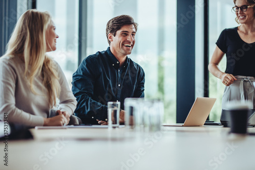 Business people smiling after a productive meeting