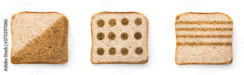 Set with toasted slices of wheat bread on white background, top view Billede på lærred
