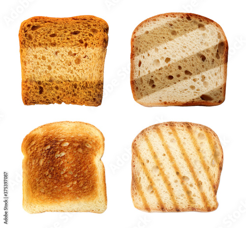 Fotografering Set with toasted slices of wheat bread on white background, top view