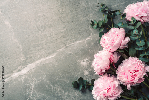 Frame pattern of pink peonies, eucalyptus flowers on marble background Fotobehang