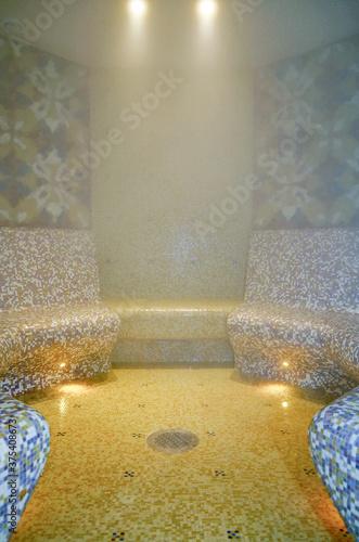 Turkish bath or steam sauna with mosaic tiles inside male locker room of spa or Canvas Print