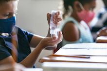 School: Boy Student Uses Bottl...