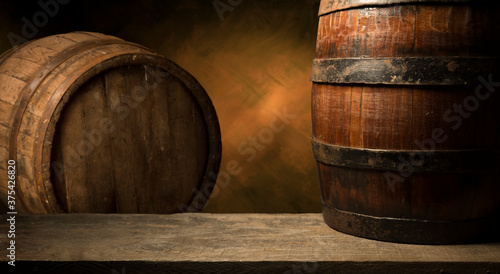 Fotografiet Old wooden barrel on a brown background