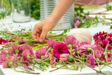 Arranging A Bouquet Of Zinnia Flowers