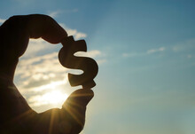 Male Hand Hold Silhouette Of D...