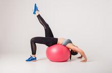 Woman Athlete Performs Exercis...