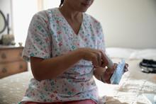 Home Caregiver Filling Pill Bo...