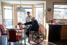 Home Caregiver Helping Senior ...