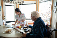 Home Caregiver Helping Senior ...