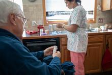 Senior Man And Home Caregiver ...