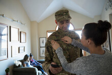 Wife Helping Soldier Husband W...