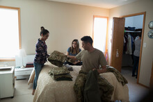 Soldier Father And Daughters Packing In Bedroom