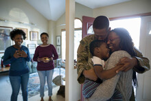 Happy Family Greeting Soldier Returning Home