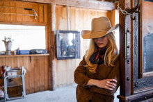 Thoughtful Female Rancher Look...