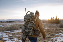Male Hunter With Backpack Walk...