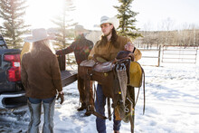 Rancher Carrying Saddle From T...