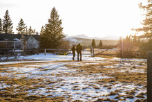 Rancher Couple On Sunny Idyllic Winter Ranch At Sunset