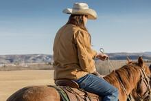 Male Rancher Horseback Riding ...