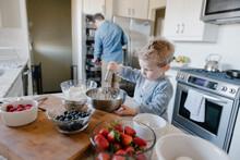 Young Boy Preparing Food In Ki...