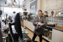 Female Worker Sanitizing Shopp...