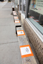Public Storefront Benches With Closed Signs During COVID-19