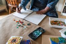 Female Artist Sketching Mosaic...