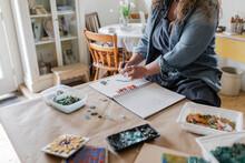 Female Artist Planning Mosaic ...