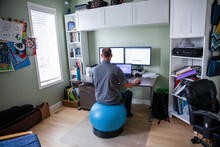 Man Sitting On Balance Ball Wo...