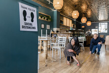 Social Distancing Notice In Cafe