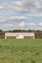 Old Farm House Barn Sky And Clouds And American Flag