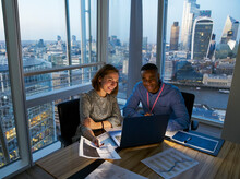 Business People Working At Laptop In Highrise Office, London, UK