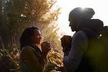 Happy Young Hiking Couple Drin...
