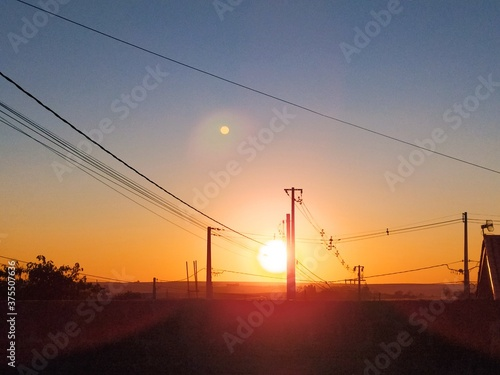 Fotografia power lines at sunset