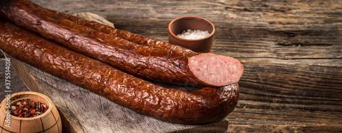 Fototapeta Wiener Sausages on a wooden background