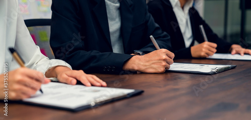 Photo Business people fill resume application information on the desk, presents the ability for the company to agree with the position of the job