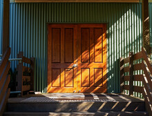 An Entry Door Highlighted By Sunlight