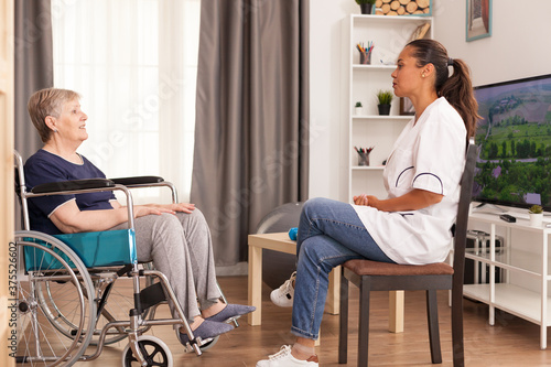 Old woman who benefits from home care service Canvas
