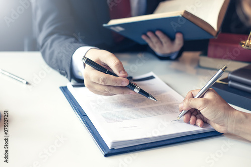Lawyer pointing to the form signing of the contract agreement.