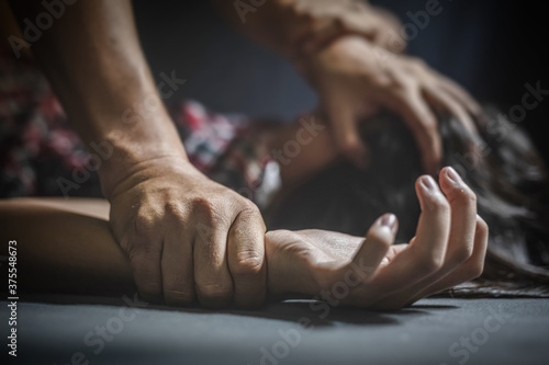 Fotomural male hand holding a woman hand for rape and sexual abuse